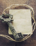 Vintage key and a note Royalty Free Stock Photo