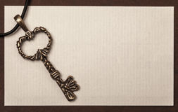 Vintage key and paper texture background Stock Image