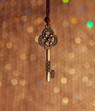 Vintage key on a shiny background Stock Photography