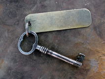 Vintage key with tag Royalty Free Stock Image