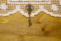 Vintage key on the white aged lace Stock Photos