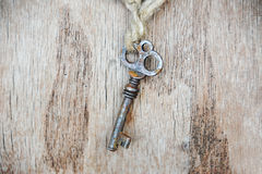 Vintage key on wooden background Stock Photography