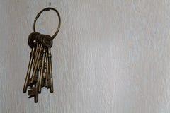 Vintage keys hanging on concrete wall Stock Photos