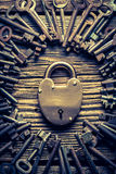 Vintage keys and locks on old wooden table Stock Images