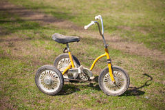 Vintage kids tricycle. Royalty Free Stock Photo