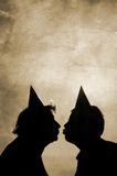 Vintage kiss. Old  grunge paper texture and funny couple Stock Photography