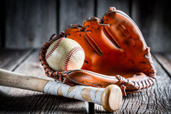 Vintage Kit to play baseball. On old wooden table Royalty Free Stock Image