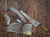 Vintage kitchen knives  collage over old wood Royalty Free Stock Photos