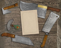 Vintage kitchen knives and utensils collage. Vintage kitchen knives and utensils over wooden  board, blank card for your text Stock Photography