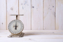 Vintage kitchen scale on countertop Royalty Free Stock Photography