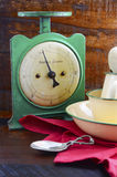 Vintage kitchen scales and tin cups and pans Stock Images
