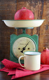 Vintage kitchen scales and tin cups and pans Stock Photography