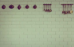 Vintage kitchen spoon  and fork hanging  ( Filtered image Royalty Free Stock Image