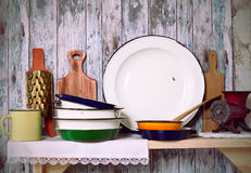 Vintage kitchen utensil. On a rustic wooden wall Royalty Free Stock Photo