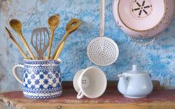 Vintage kitchen utensils. Spatulas, coffee can,skimmer, china bone coffee filter stock photo