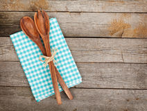 Vintage kitchen utensils over wooden table Stock Images