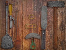 Vintage kitchen utensils over wooden wall Royalty Free Stock Images