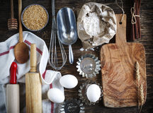 Vintage kitchen utensils, props and ingredients. Vintage kitchen utensils, props and ingredients on a rustic wooden table. Baking concept Royalty Free Stock Photos