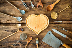 Vintage kitchen utensils. On wooden table royalty free stock photo
