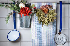 Vintage kitchen wall with rag, spoons and spices Royalty Free Stock Photos