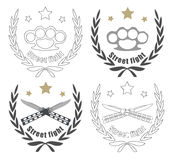 Vintage knife and brass-knuckle emblems. Color, and line art logos  on white with 2 crossed knifes, brass knuckle and stars in laurel wreath frame Royalty Free Stock Photography