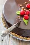 Vintage knife cutting a chocolate cake. Royalty Free Stock Images