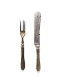 Vintage knife and fork with the original design on the handles on a white background Stock Photos