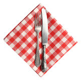 Vintage knife and fork on red plaid linen napkin isolated. Royalty Free Stock Images