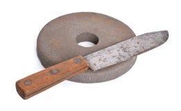 Vintage knife with Old abrasive wheel Stock Photo