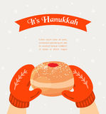 Vintage knitted mittens holding a Hanukkah donut Royalty Free Stock Photo