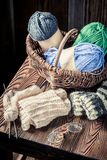 Vintage knitted scarf with color skein. On wooden table Royalty Free Stock Images