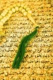Vintage koran and muslim prayer beads. Close up shot of Vintage koran and muslim prayer beads. Shot in studio during Ramadan Royalty Free Stock Image