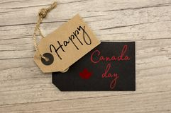 Happy Canada day. Vintage kraft tags writing happy Canada day Stock Photography
