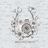 Vintage label with camera and flowers. On the paper background.Vintage style Stock Photos