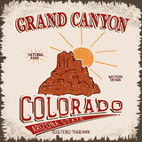 Vintage label with canyon and sun. Grunge effect.Typography design for t-shirts Royalty Free Stock Images