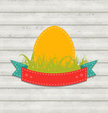 Vintage label with Easter egg on wooden background Stock Images