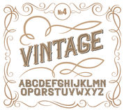 Vintage label font. Alcogol label style. Vintage label font. Alcogol label style with vintage ornament stock photos