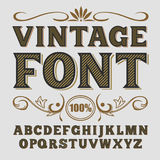 Vintage label font. Alcogol label style. Vintage label font. Alcogol label style with vintage ornament stock photo