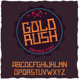Vintage label font named Gold Rush. Good to use in any creative labels Royalty Free Stock Image