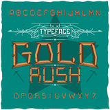 Vintage label font named Gold Rush. Stock Image