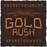 Vintage label font named Gold Rush. Good to use in any creative labels Stock Images