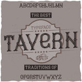 Vintage label font named Tavern. Good to use in any retro design labels of alcohol drinks Royalty Free Stock Photos