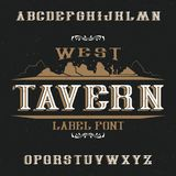 Vintage label font named Tavern. Good to use in any retro design labels of alcohol drinks Royalty Free Stock Images