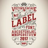 Vintage label font. Whiskey label style with vintage ornament Royalty Free Stock Images