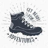 Vintage label, grunge textured Hand drawn retro badge or T-shirt typography design with hiking shoe, trekking boot vector illustra Stock Image