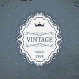 Vintage label with royal crown and grunge background. Royalty Free Stock Image