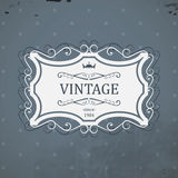 Vintage label with royal crown and grunge background. Royalty Free Stock Photography