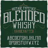 Vintage label typeface named Blended Whisky. Stock Photos