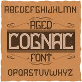 Vintage label typeface. Named Cognac. Good font to use in any vintage labels or logo Royalty Free Stock Photo