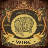 Vintage label with wine barrel and bunch of grapes on wooden background.  elements. Stock Image